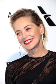 Sharon Stone attended the Elton John AIDS Foundation Oscar-viewing party wearing this short side-parted 'do.