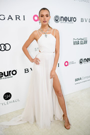 Josephine Skriver channeled summer in a flowing white cutout dress by Prabal Gurung at the Elton John AIDS Foundation Oscar-viewing party.