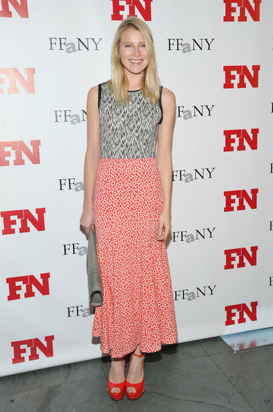 Dree Hemingway topped off her multi-printed dress with bright red platform sandals.