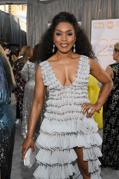 Angela Bassett attended the 2019 SAG Awards carrying a studded gray clutch by Tadashi Shoji.