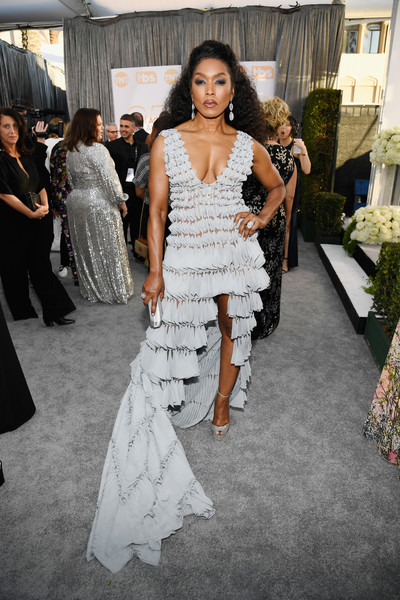 Angela Bassett looked fierce at the 2019 SAG Awards in an architectural Georges Chakra Couture gown with a plunging neckline and a high-low hem.