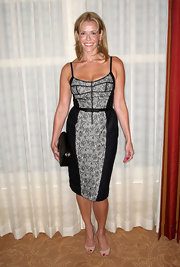 Chelsea Handler paired her lace clad dress with nude peep toe pumps.