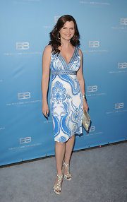 Heather Tom topped off her printed dress with strappy sandals complete with studded detailing.