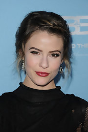 Linsey Godfrey wore her hair in a bobby-pinned updo featuring twisted bangs and feather face-framing strands.