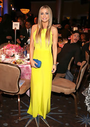 Carmen Electra's sparkly blue clutch was a bright contrast to her bold yellow gown.