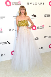 Jaime King looked heavenly in an Oscar de la Renta strapless gown boasting a voluminous tulle skirt and a sparkly gold bustline at the Elton John AIDS Foundation Oscar-viewing party.