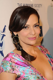 Constance Marie arrived at the 26th Annual Genesis Awards wearing her hair in a simple braid with long side-swept bangs.