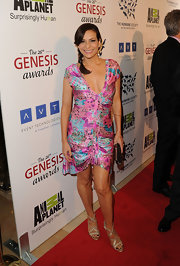 Constance Marie wore a pair of muted metallic gold sandals with braided detail at the 26th Annual Genesis Awards.