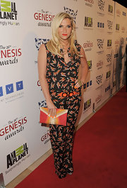 Kesha looked daring, as always, in this statement print jumpsuit to the Genesis Awards.