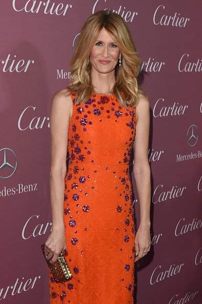 Laura Dern paired a perforated gold clutch with a bright orange dress for the Palm Springs International Film Festival Awards.
