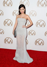 Christian Serratos arrived looking elegant at the 26th Annual Producers Guild Of America Awards in a stunning strapless gown with sheer detail.