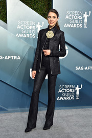 Margaret Qualley rocked a shiny black pantsuit by Chanel at the 2020 SAG Awards.