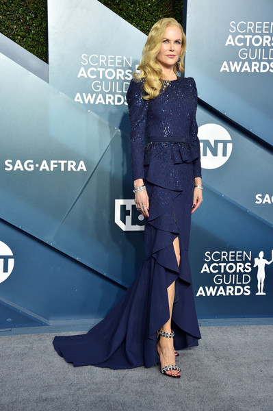 Nicole Kidman looked demure and elegant in a navy sequined peplum gown by Michael Kors at the 2020 SAG Awards.