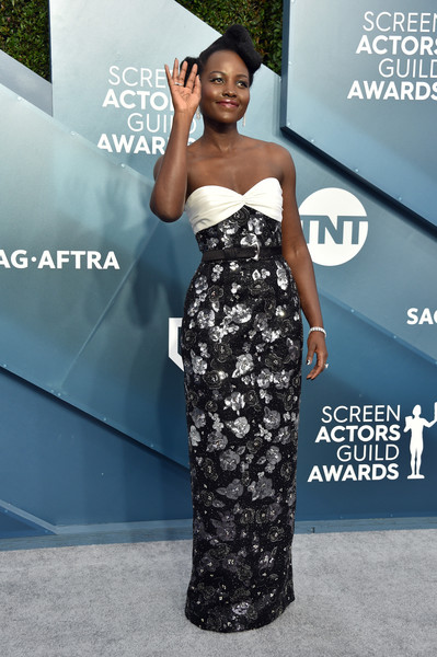 More Pics of Lupita Nyong'o Curly Updo (2 of 10) - Updos Lookbook - StyleBistro [clothing,dress,shoulder,carpet,premiere,fashion,strapless dress,red carpet,fashion model,hairstyle,arrivals,lupita nyongo,screen actors guild awards,screen actors\u00e2 guild awards,the shrine auditorium,los angeles,california,lupita nyongo,screen actors guild awards,sag-aftra,red carpet,actor,celebrity,red carpet fashion,fashion,screen actors guild award for outstanding performance by a female actor in a leading role]