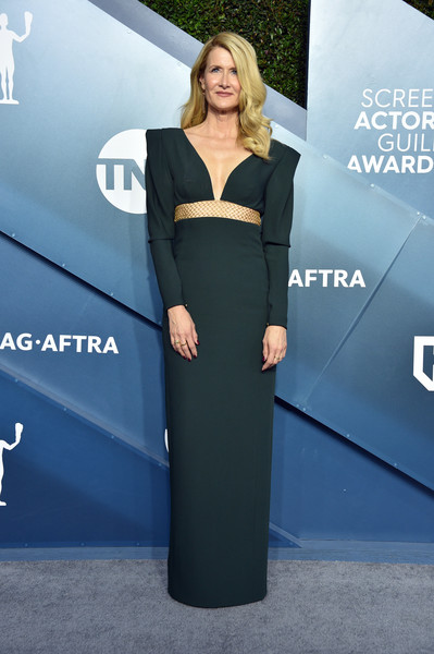 Laura Dern rocked a bold-shouldered green column dress by Stella McCartney at the 2020 SAG Awards.