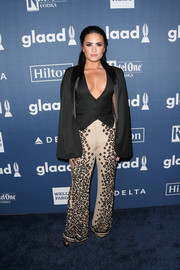 Demi Lovato rounded out her look with a black cape, also by Sass & Bide.