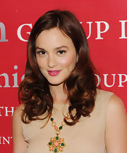 Leighton wears a beautiful berry color lipstick with her neutral ensemble.