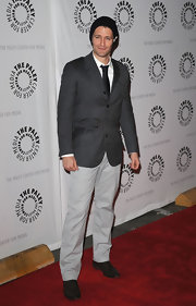 Matthew Morrison looked polished in a gray pin striped suit with an interesting belt closure.