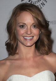 """Glee"" cast member Jayma showed off her signature strawberry blonde bob. She opted for a slight curl while attending this event."