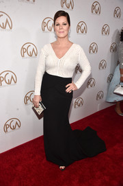 Marcia Gay Harden styled her gown with a printed box clutch.