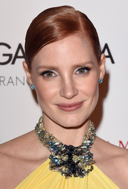 Jessica Chastain's blue Suzanne Kalan studs worked beautifully with her bejeweled yellow dress at the American Cinematheque Award.