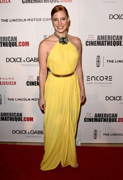 Jessica Chastain attended the American Cinematheque Award looking like a goddess in a bright yellow draped halter gown by Givenchy Couture.
