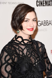 Anne Hathaway's bold red lipstick totally popped against her fair complexion.