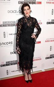 Anne Hathaway was grunge-glam in a rope-embellished, sheer LBD by Christopher Kane during the American Cinematheque Award.