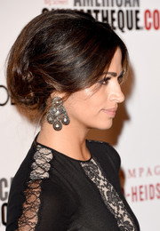 Camila Alves complemented her elegant hairstyle with diamond chandelier earrings by Neil Lane.