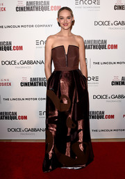 Jess Weixler went for modern glamour in a brown Alberta Ferretti strapless gown, featuring a split neckline and a metallic skirt, during the American Cinematheque Award.