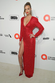Josephine Skriver matched her dress with a pair of red ankle-tie pumps.