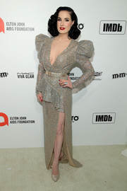 Dita Von Teese coordinated her look with a pair of glitter pumps.