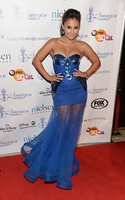 Francia's cobalt blue strapless dress featured a flowing sheer skirt and bold jewel on the bodice.