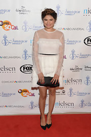 Melonie Diaz kept her look soft and pretty with a sheer long-sleeve white ruffle dress.