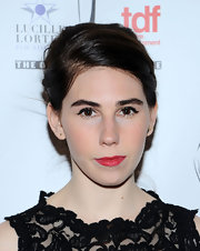 Zosia Mamet matched her classy dress with an equally elegant chignon at the Lucille Lortel Awards.