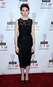 Zosia Mamet achieved timeless elegance with this lace-overlay LBD at the Lucille Lortel Awards.
