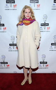 Nellie McKay donned a retro wool coat, spruced up with a colorful scarf, for the Lucille Lortel Awards.
