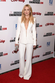 Kate Hudson gave her white Brandon Maxwell pantsuit a sexy punch by wearing it sans shirt during the American Cinematheque Awards.