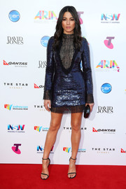 Jessica Gomes shimmered on the ARIA Awards red carpet in a blue Manning Cartell sequin dress with black net detailing.