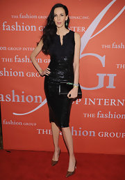 The sequins and ruffle detailing on L'Wren Scott's cocktail dress made her ready for any kind of party.