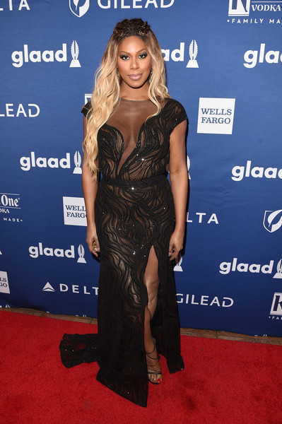Laverne Cox looked seductive in a sheer black gown by Tadashi Shoji at the 2018 GLAAD Media Awards.