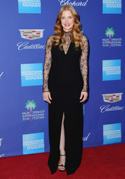 Jessica Chastain complemented her gown with black slim-strap heels, also by Givenchy.