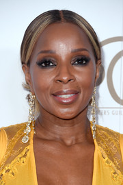 Mary J. Blige styled her hair into a center-parted chignon for the 2018 Producers Guild Awards.