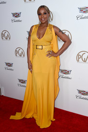 Mary J. Blige chose an Elie Saab cape-sleeve gown in an eye-popping yellow hue for her 2018 Producers Guild Awards look.