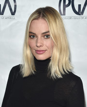 Margot Robbie kept it casual with this flippy 'do at the 2018 Producers Guild Awards nominees breakfast.