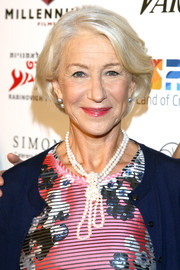 Helen Mirren styled her look with a layered and knotted pearl necklace.