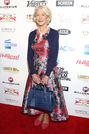 Helen Mirren topped off her dress with a navy cardigan.
