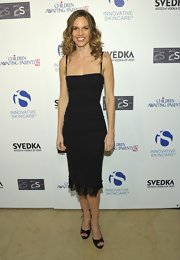 Hilary Swank looked super slim in a classic LBD with a lace hem and spaghetti straps at the Children Awaiting Parents Fund.