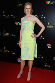 Nicole looked as lovely as ever in this lemon cocktail dress with rich pale blue embroidery.