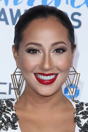 Scarlet red lips exemplified Adrienne Bailon's timeless beauty.